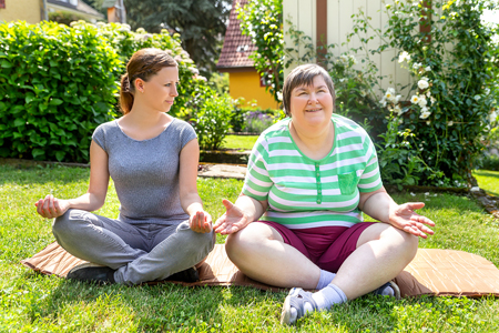 adult woman with disability enjoying outdoors at group home